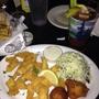 Six Feet Under Pub & Fish House - Atlanta, GA. Catfish filets, hush puppies and coleslaw