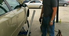 Economy Hi-Tread Tire Center - Scottsboro, AL. Our mechanic, Donvan changing the tires and oil on a vehicle