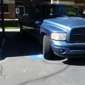 Stout Management Co - Las Vegas, NV. Maintenance illegally parked in covered handicap for residents.