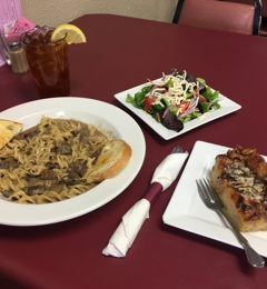 Family Bistro - Leavenworth, KS. The beef stroganoff with salad and AMAZING bread pudding... a must try!