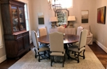 Casual comfort in this elegant dining space is completed with a Persian Overdyed Tabriz through elements of soft color and pleasing pattern.