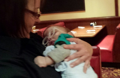 Mimi's Cafe - Atlanta, GA. Super attentive waitress,  holding our Timmy after meal.