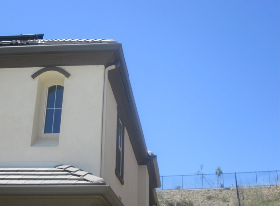 AAA Pro 1 Rain Gutters - San Marcos, CA. Downspout matches wall color.