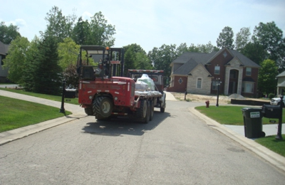 Northville Lumber Co - Northville, MI. Here is a picture of the driver Steve and his driver that clipped my lawn.  My lawn is where the fire truck is.