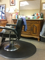 Comfortable barber chair in a pleasant environment.
