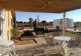 Palms of Paradise RV Park - Gardendale, TX