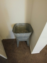 Very old wash tub with an inside drain