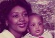 Dr. James P. DeRossitt III., M.D. - Forrest City, AR. Mrs. E. Brown, age 21 with son-Derek