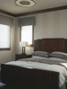 Bedroom custom blinds shades installed by Benjamin Draperies