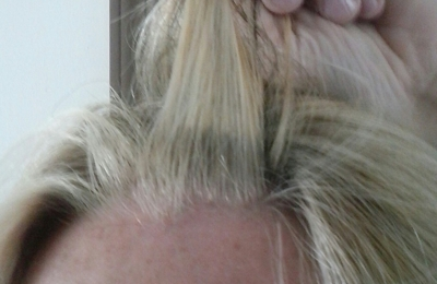 Famous Hair - Decatur, IN. Paid right under 50.00 and it looks like my roots weren't even touched.