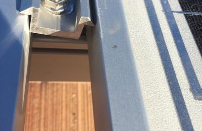 Poweraid Inc. - Irvine, CA. Several panel brackets were left unattached.
