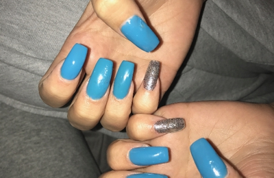 Lady Nails - Columbus, OH. In the photo you can see the different nail shape, the nails that have 2 darker blue on them, and they weren't dry after 30 min