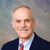 Dr. Gregory E. Lyman, MD