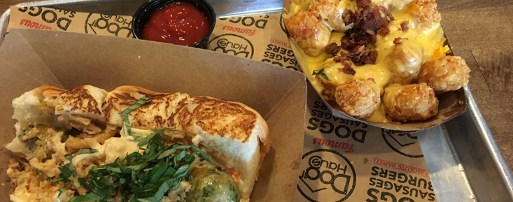 Bad Mutha Clucka sausage sandwich and bacon cheesy tots
