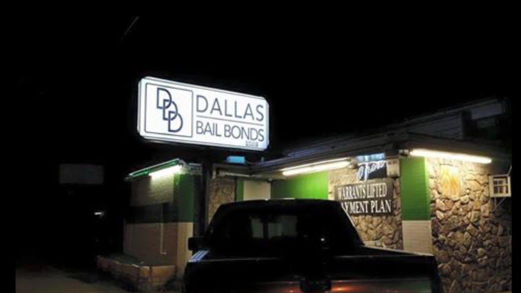 DDD Bail Bonds in Dallas storefront sign at night