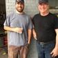 Economy Hi-Tread Tire Center - Scottsboro, AL. Owner, Chris Rodgers, poses with a customer