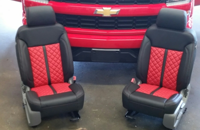 Dale olano DBA Upholstery Limited LLC - Baton Rouge, LA. 2016 Silverado: Black leather interior, Red Platini inserts, black stripe, and contrasting stitch. Red door panel inserts.