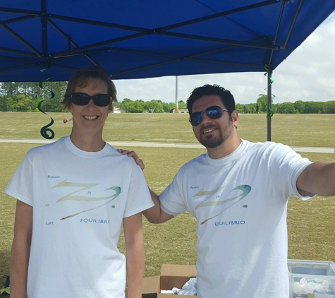 Ecuilibrio Home Health - Virginia Beach, VA. 2 members of the Equilibrio team at a Corporate Challenge event with the Chamber of commerce in Chesapeake April 2016.