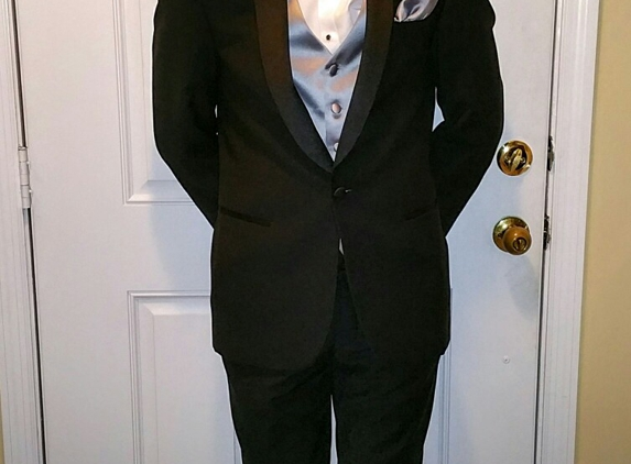 Men's Wearhouse - Nashville, TN. Slim fit Clvin Klein with silver vest and accents. Blue bowtie.