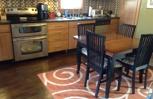 Complete kitchen remodel. Cabinets, appliances, tile work, and hardwood floor refinished.