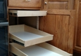 Slide Out Shelf Solutions - Wichita, KS. Installed two pullouts and also one at the top that now is another drawer.