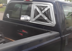 Safelite AutoGlass. Rear window on the passenger side of the truck is broken.