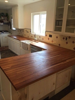 L-Shape Butcher Block Countertop with an Under Mount Farm House Sink
