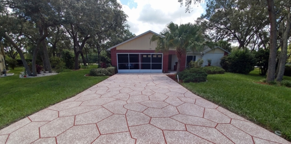 Ace Advanced Coating Experts - Weeki Wachee, FL. Modified Texture with Stone design to include cracks. Red Base with Buff & White